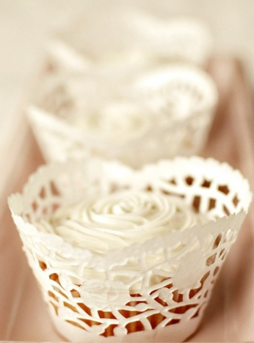 cupcakes with white rose icing on them are a timeless wedding dessert idea for any season