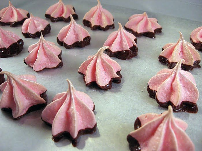 pink meringue kisses dipped into chocolate are delicious and easy wedding favors or desserts