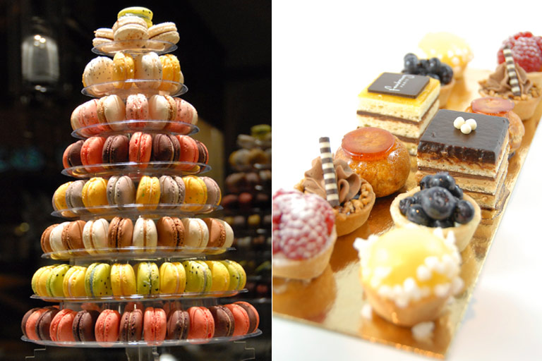 a macaron tower and delicious mini desserts topped with cream, berries, fruits