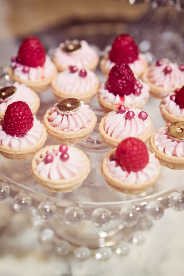 mini tartlets with pink whipped cream, edible beads, fresh raspberries, chocolate on top