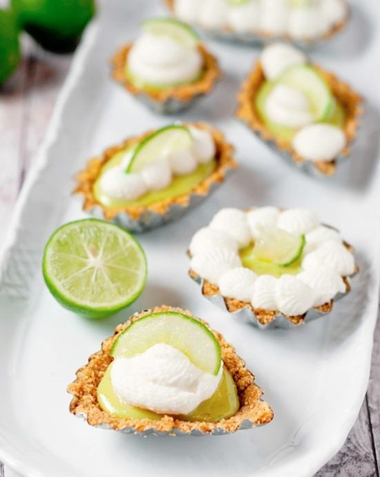 mini tartlets with fruit cream, whipped cream, citrus slices on top are very refreshing and summer like