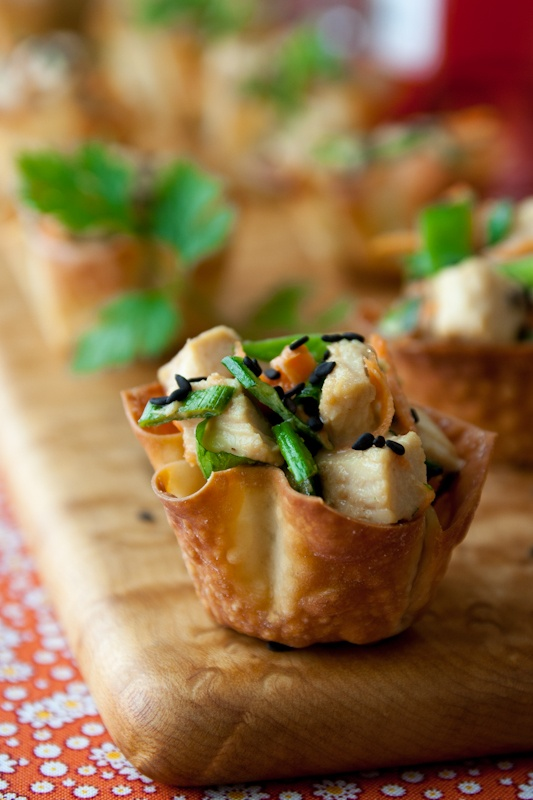 edible cups filled with salad of vegetables and chicken and sesame seeds are hearty and tasty