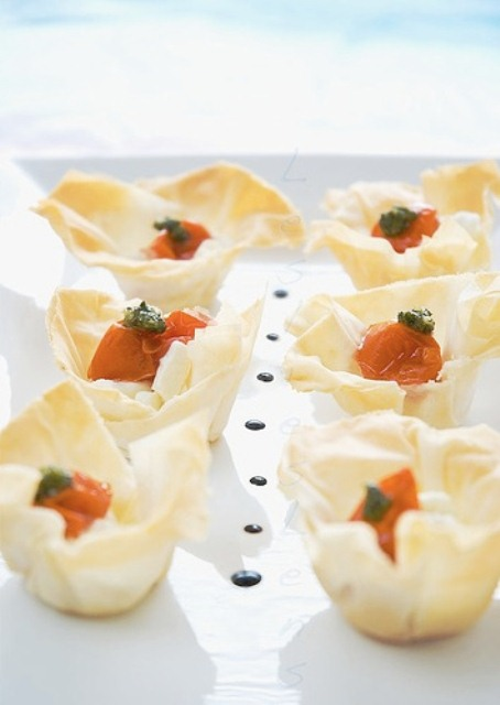 baked cups with feta cheese and sun dried tomatoes are hearty summer wedding appetizers