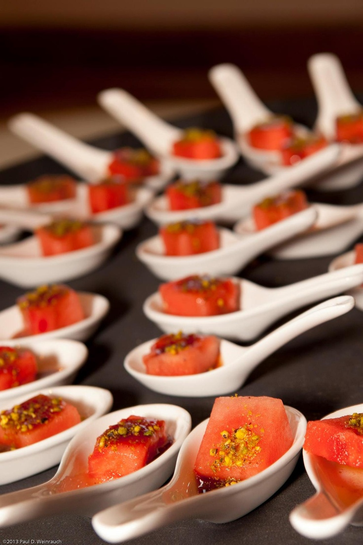 fresh watermelon cubes with pistachios and condiments is a very summer inspired appetizer you'll love