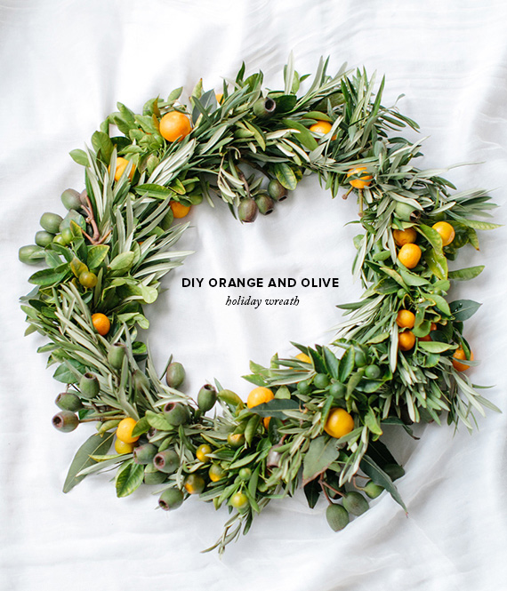 Picture Of diy orange and olive wreath for holiday weddings  1