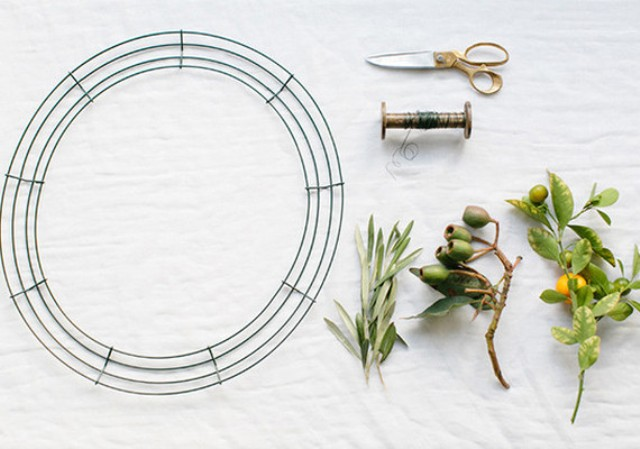 Picture Of diy orange and olive wreath for holiday weddings  2
