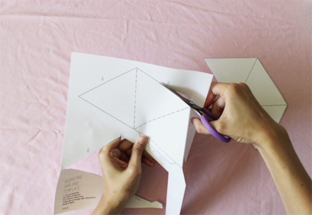 Picture Of diy triangle garland for wedding reception decor  3