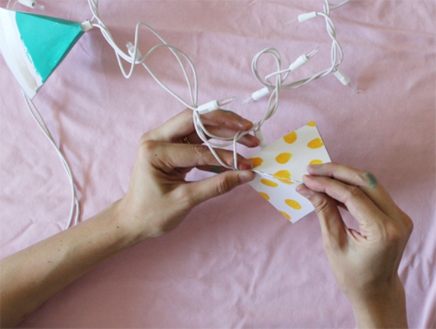 Picture Of diy triangle garland for wedding reception decor  7