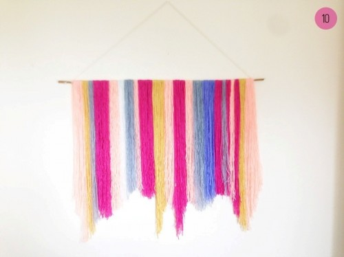 colorful yarn backdrop (via weddingomania)