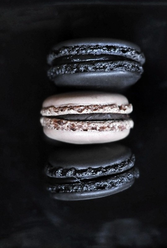chic black and white macarons can be a nice dessert or favor idea for a soft gothic wedding