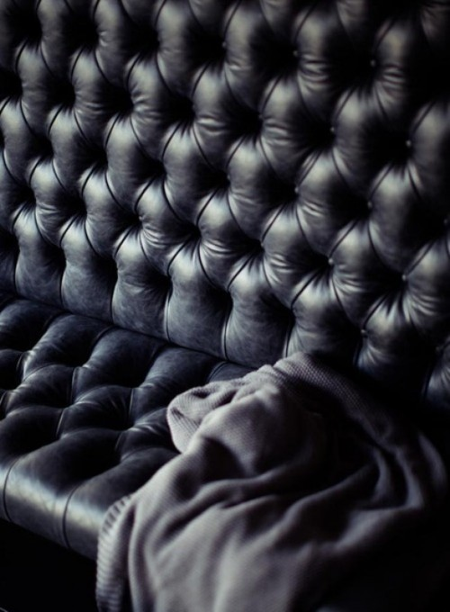 a black upholstered sofa is a cool idea for styling a soft gothic wedding lounge