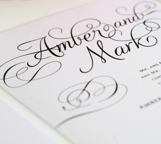 elegant white wedding stationery with black calligraphy for a soft gothic wedding