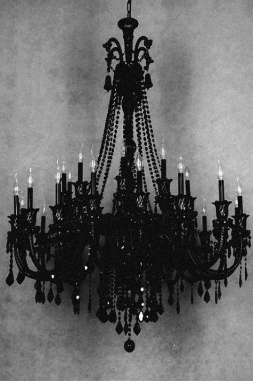 a bold black chandelier with bulbs is a gorgeous idea for a soft gothic wedding
