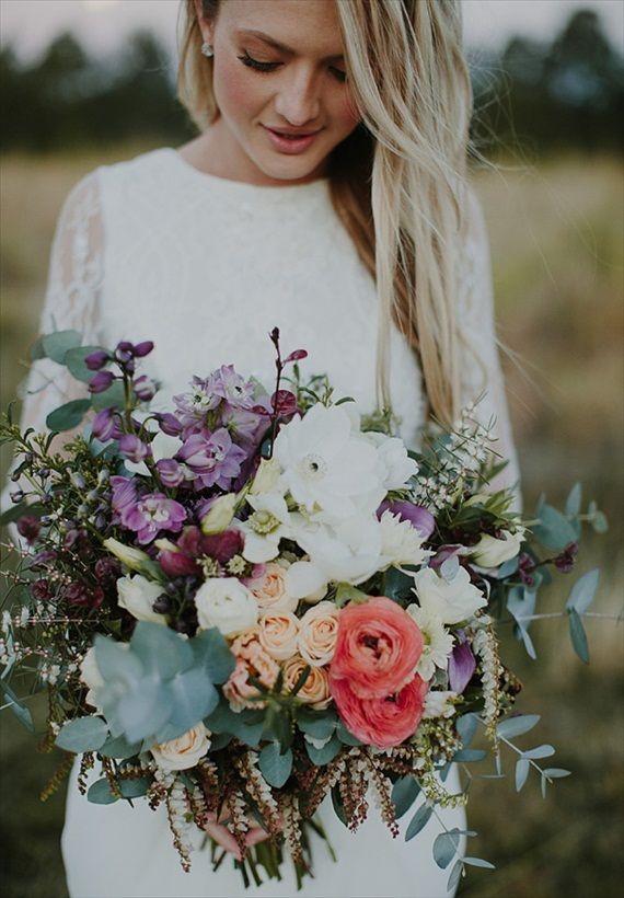 a bright wedding bouquet of white, coral and purple blooms and lots of pale greenery will fit a boho bride