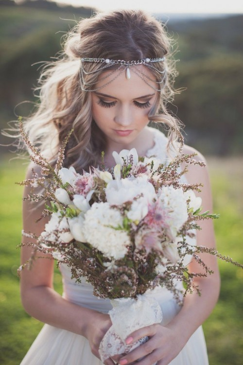 a pale boho wedding bouquet in white, pink and with some grasses is a cool idea for a summer or spring boho bride