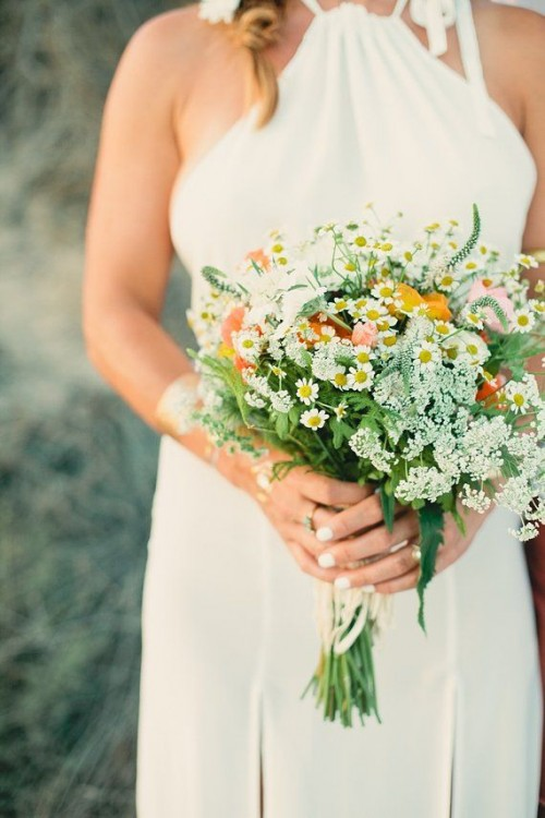 a neutral summer wedding bouquet in white, yellow with lots of wildfowers and some greenery