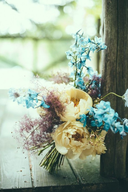 a pastel wedding bouquet in powder blue, pink, muted yellow looks very unusual and fits a spring boho bride