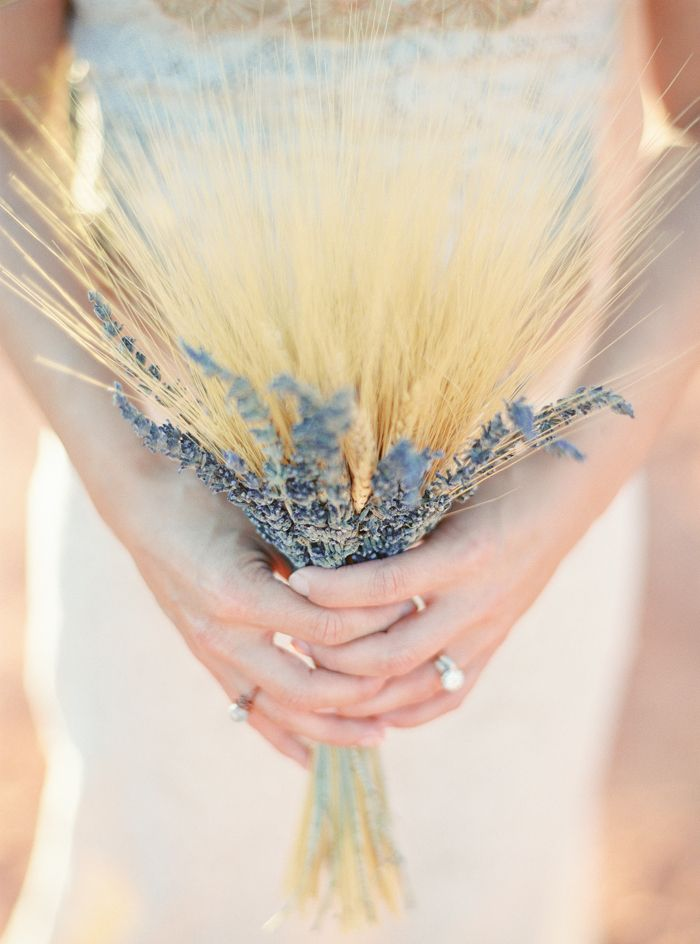 a rustic wedding bouquet of lilac and wheat is a nice idea for a summer to fall or just summer boho bride