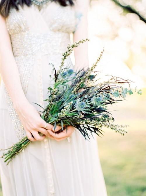 a greenery, thistle, eucalyptus wedding bouquet for a spring or summer boho bride