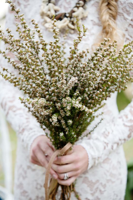 a boho spring wedding bouquet of blooming branches is a nice solution for a spring boho bride