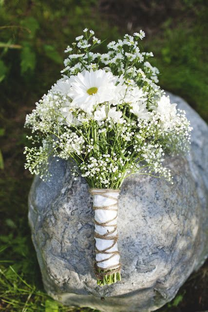 a wild bouquet of baby's breath and white camomiles is a nice idea for a spring or summer bride