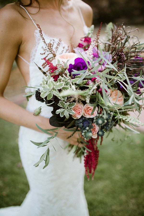 a bright wedding bouquet with blush and purple blooms, textural greenery, dried elements and grasses