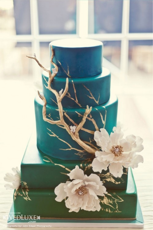 a green square and blue round wedding cake with sugar blooms and gold driftwood and painted gold branches on the cake