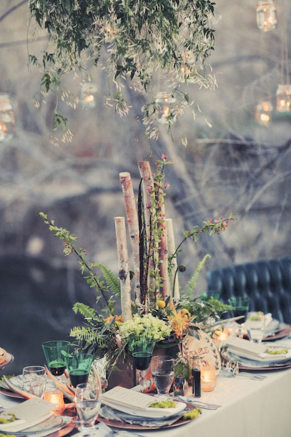 a woodland wedding centerpiece of greenery, branches, blooms, ferns can be easily composed by you yourself