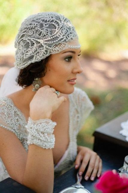 Juliet cap veil with embellishments, matching bracelets and vintage earrings help to create a refined and beautiful bridal look
