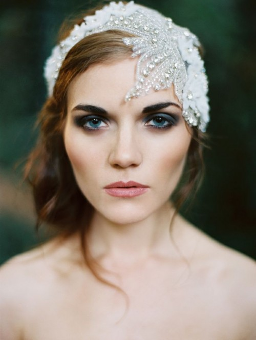 a white fabric floral headband with rhinestones and lace is a beautiful option for an art deco or vintage bride