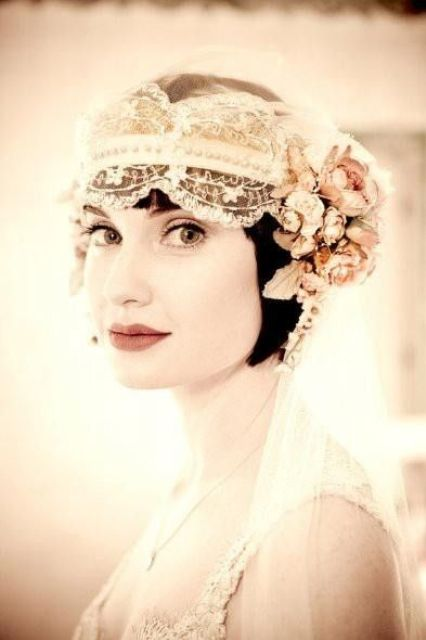 a vintage lace headband with embellishments and dried blooms and leaves and a veil for a vintage bride