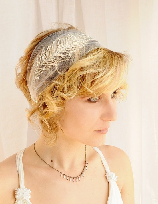 a sheer headband with beaded feathers is a beautiful idea for an art deco bride
