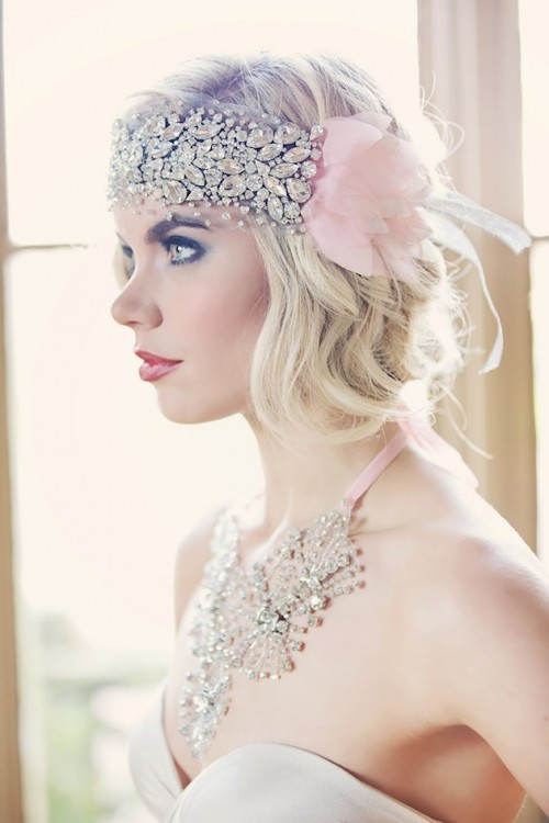 a heavily embellished headband with pink fabric blooms and a matching statement necklace for an art deco look