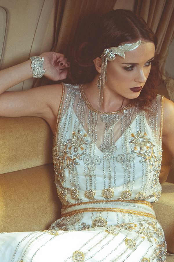 an art deco bridal headpiece with rhinestones hanging down is a lovely and chic idea for an art deco bride