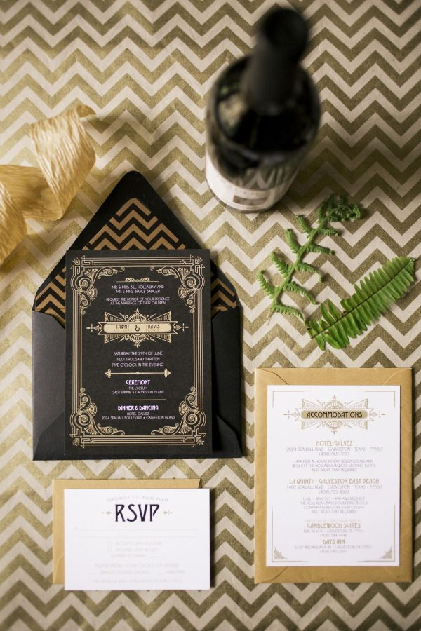 a black, white and gold wedding invitation suite with an elegant chevron print