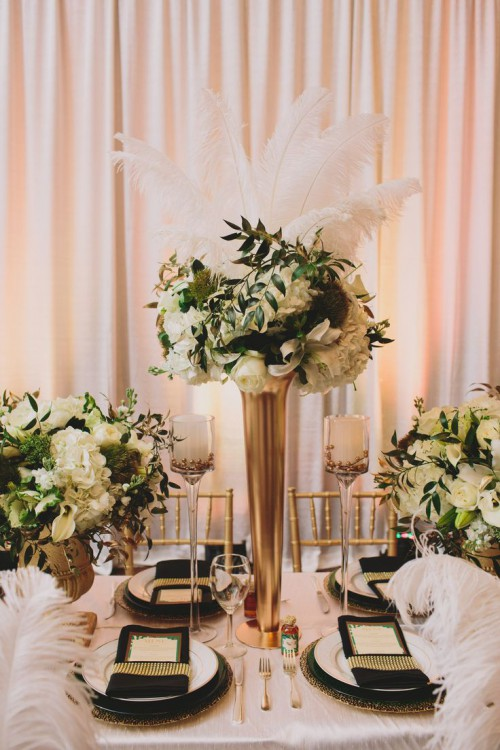 gold vases and cutlery, black and gold place settings, white bloom centerpieces