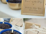 a navy and gold bowl with coffee beans to take home as wedding favors