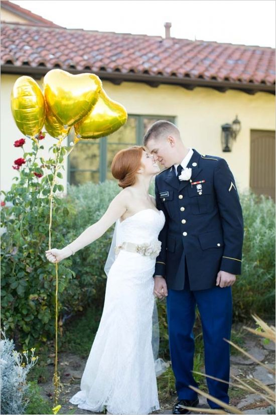 the groom wearing navy and gold balloons instead of a traditional bridal bouquet