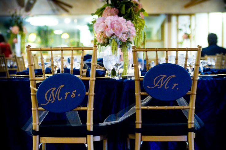 gold chairs with navy and gold signage for an elegant wedding