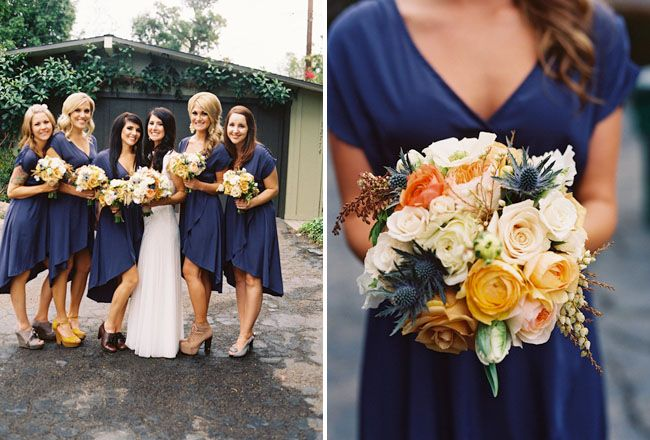 bridesmaids wearing high low navy knee dresses and holding yellow and gold bouquets
