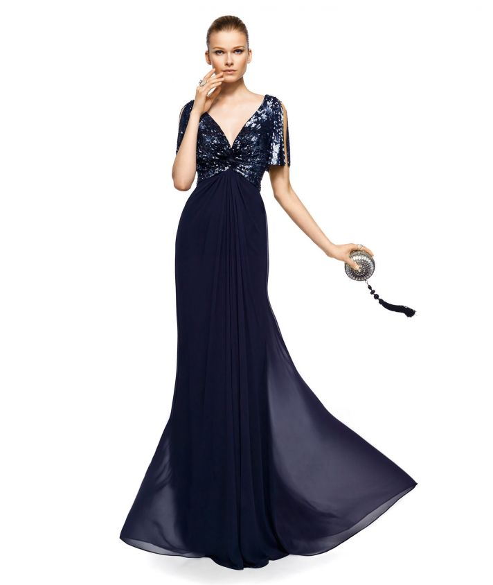 a midnight blue A line mother of the bride dress with an embellished bodice, cutout sleeves and a pleated and flowy skirt with a train is very formal and elegant