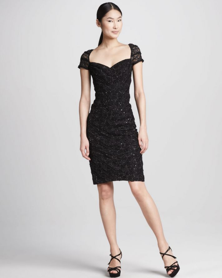 a black embellished over the knee dress with a deep neckline and cap sleeves is a very refined and chic idea to rock