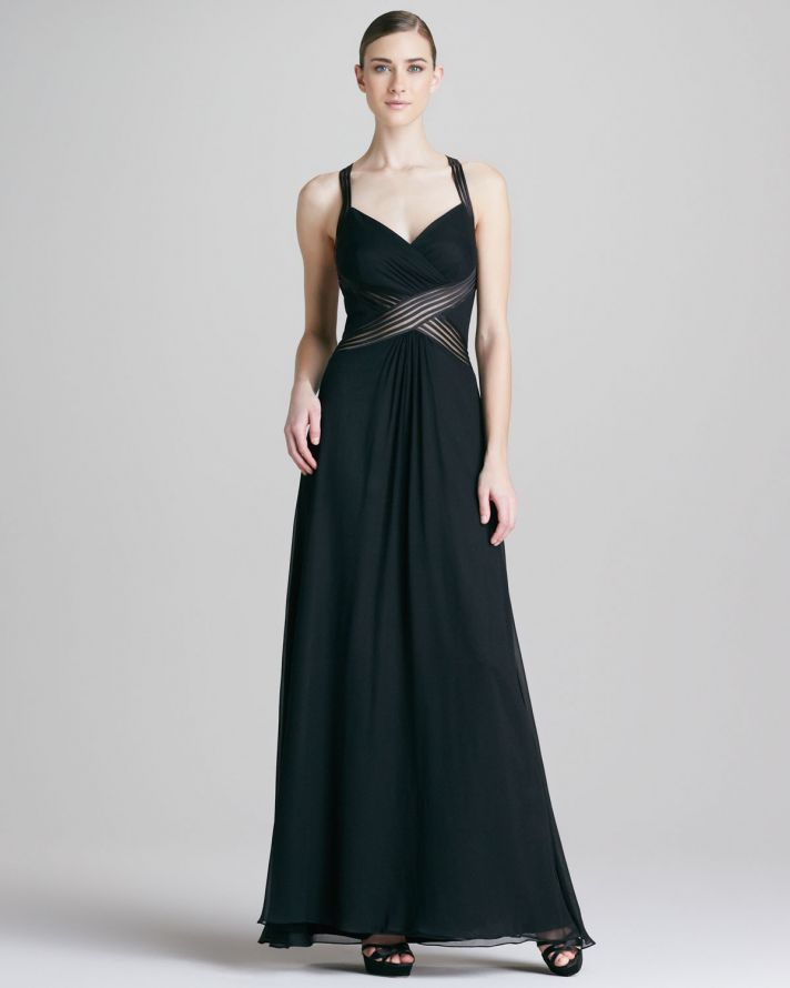 a black A line maxi dress with thick straps and striped accents on the waist is a very chic and laconic idea to rock