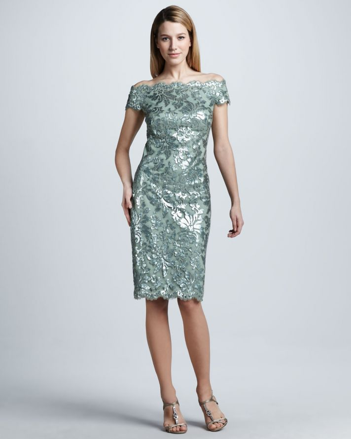 a shiny green off the shoulder botanical fitting knee dress is a stylish and beautiful option for a mother of the bride