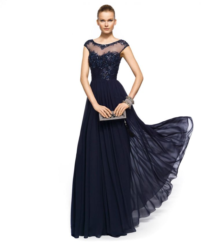 a refined midnight blue mother of the bride dress with an embellished bodice, a pelated skirt and an illusion neckline plus statement accessories