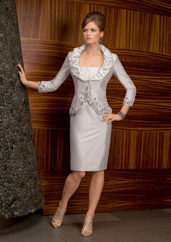 a formal neutral look with a strapless fitting knee dress and an embellished and embroidered blazer with long sleeves is super elegant