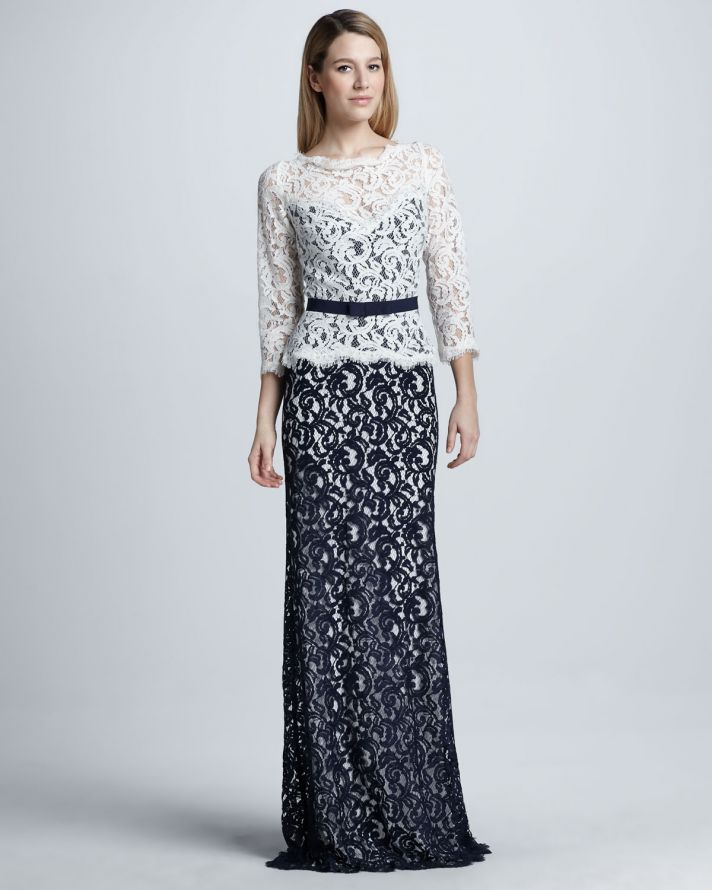 a stylish mother of the bride look with a white lace long sleeve top over a navy lace fitting maxi dress