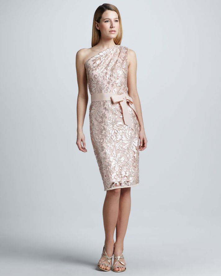 a blush lace fitting one shoulder knee dress with a bow and strappy silver shoes will make the look super refined