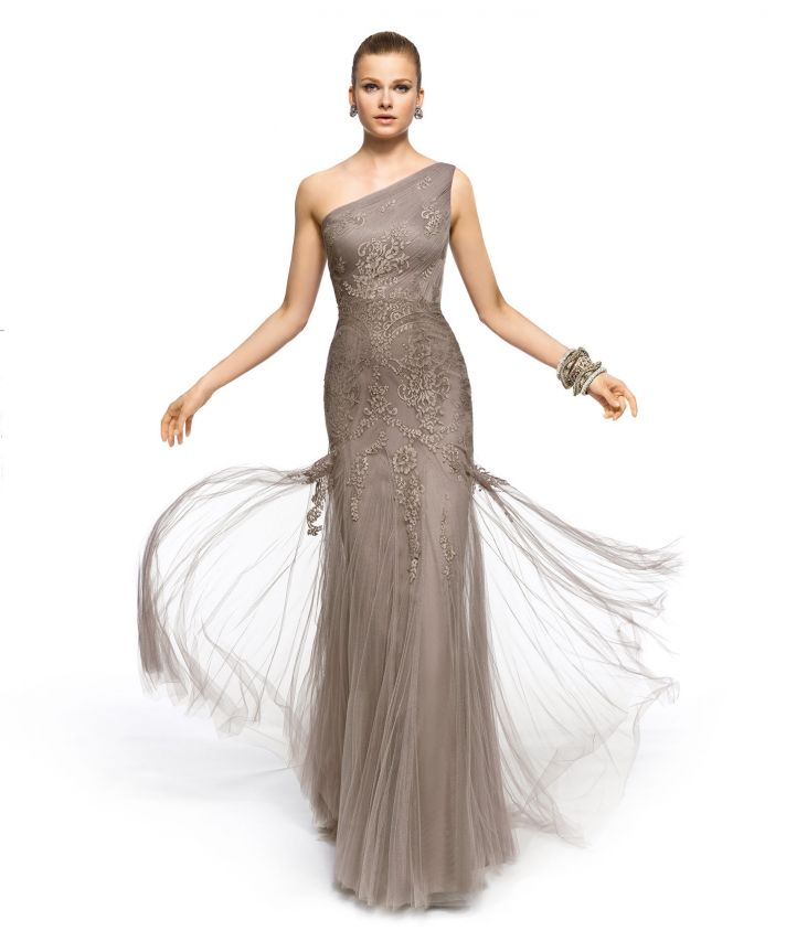 a grey one shoulder lace fitting maxi dress with a slight overskirt and fringe is a super elegant and refined idea to rock
