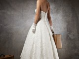 a lace sstrapless A-line tea length wedding dress, gloves, shoes and a veil with a fabric bloom for a vintage look